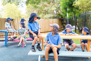 St Declan's Catholic Primary School Penshurst students chatting on a bench